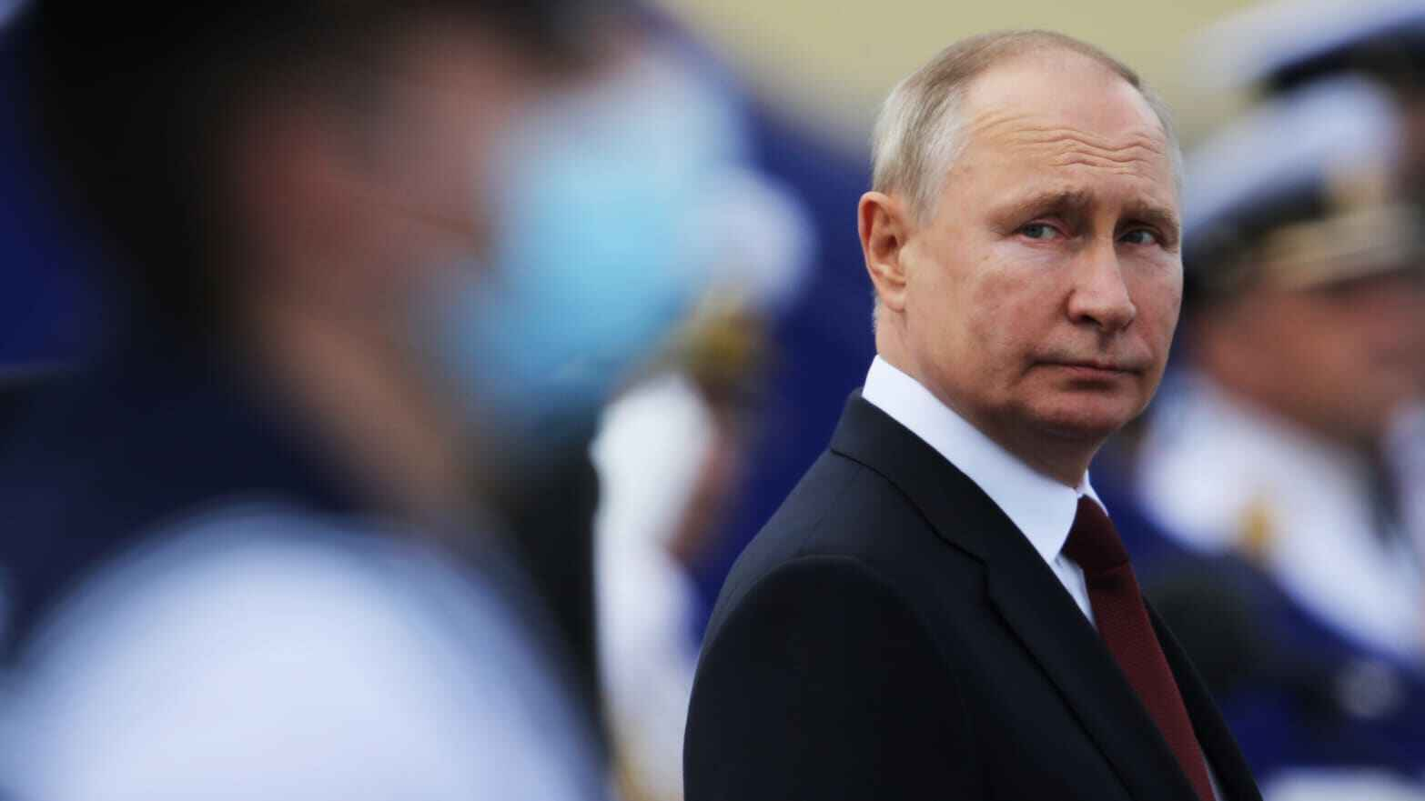 Putin continues his work as usual under self-isolating conditions
